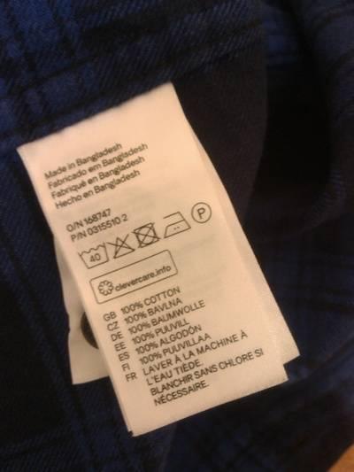 Этикетка рубашки с H&M
