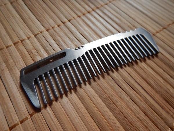 Расчёска из титана с eBay